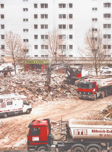Demolition of the East Gate in Berlin, several BTB trucks transport the construction waste away from the construction site